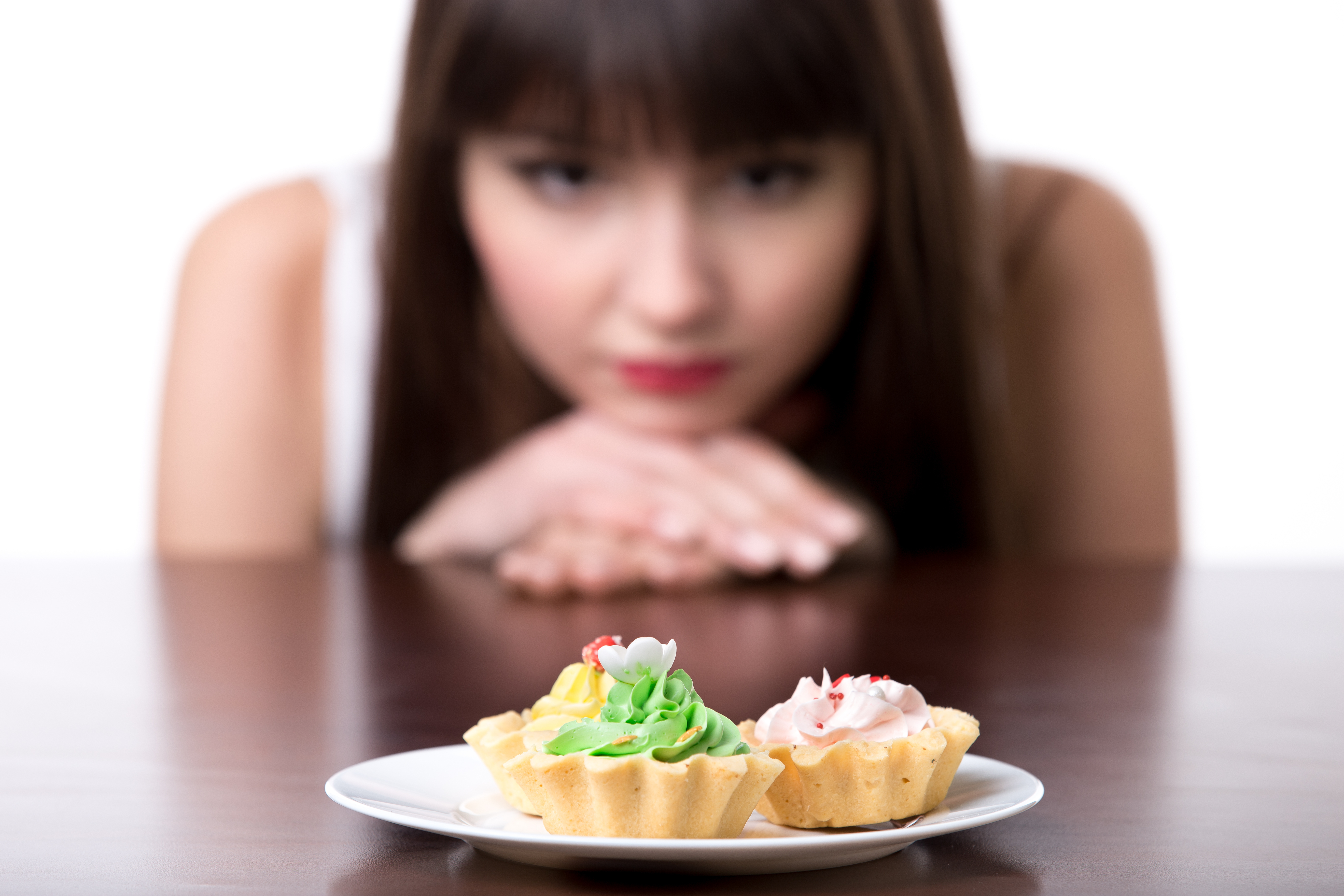 Young,Dieting,Woman,Sitting,In,Front,Of,Plate,With,Delicious